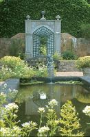 Pond and statue in private garden